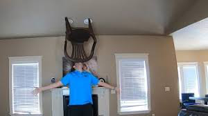 √ Idaho man balances chair on chin for over an hour to break world record - Interesting news